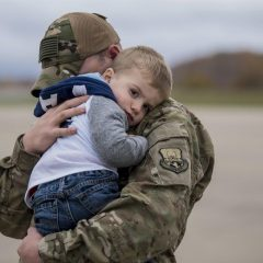 soldier-holding-boy